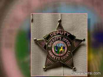 Harnett County deputies wearing pink badges for breast cancer awareness
