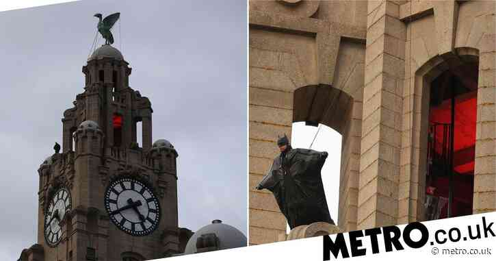 Batman spotted on top of Liverpool's Liver Building as stunts are filmed for new movie