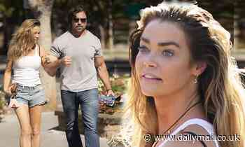 Denise Richards rocks a white tank top with shorts for lunch with husband Aaron Phypers in Calabasas