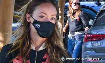 Olivia Wilde sends a message wearing an I Am A Voter face mask while out running errands in LA