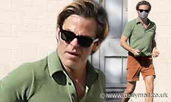 Chris Pine keeps it casual in polo short and shorts as he heads to the studio on hot fall day in LA