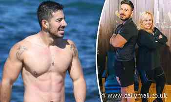 Celebrity personal trainer Jono Castano shows off his six-pack at the beach