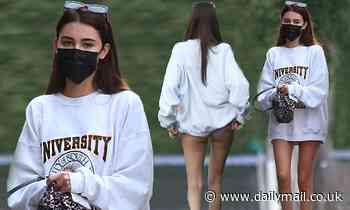 Madison Beer puts on a VERY leggy display in oversized white jumper as she steps out for dinner