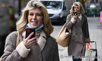 Kate Garraway flashes a smile as she chats on the phone amid husband Derek's coronavirus battle