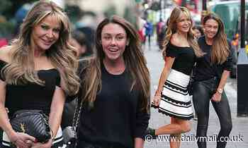 Lizzie Cundy catches the eye in a flirty minidress as she dines out with Michelle Heaton
