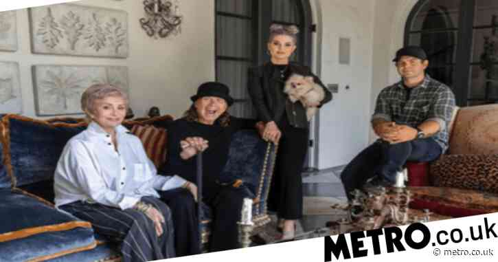 Kelly Osbourne holds dad Ozzy's hand as First Family of Darkness unite for family portrait