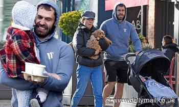 Kelvin Fletcher is every inch the doting dad on a family stroll with wife Liz and new puppy