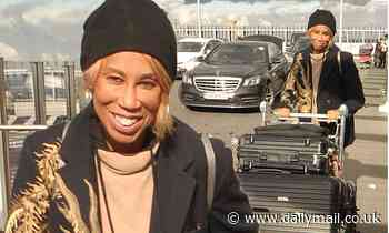 Trisha Goddard smiles as she prepares to jet home to the US after filming pilot chat show