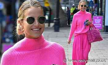 Vogue Williams looks radiant as ever in a bright pink jumper and matching skirt