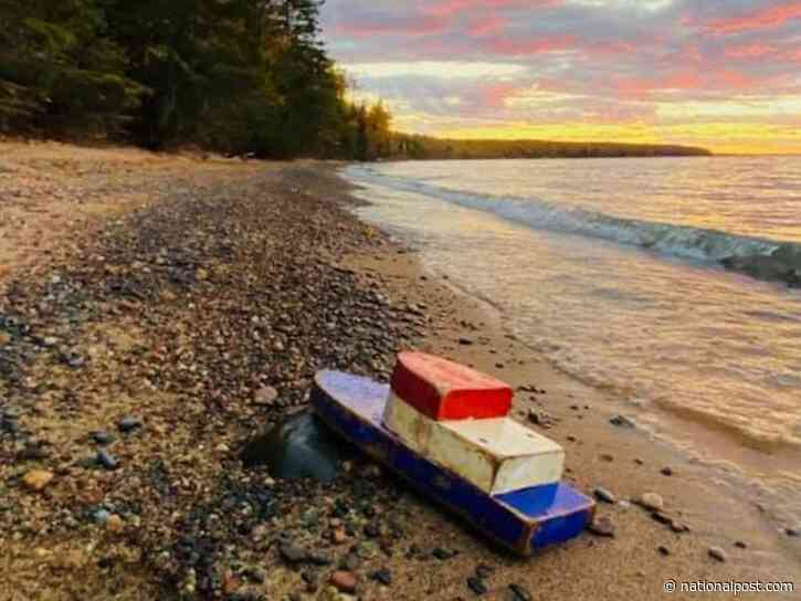 Wooden toy boat washes ashore on Lake Superior after 27 years adrift