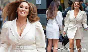 Kelly Brook wears cream tuxedo mini dress at Heart FM Studios