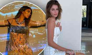 Kaia Gerber looks white-hot in little Givenchy dress while modeling their latest collection