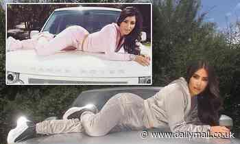 Kim Kardashian recreates 2007 pose as she sprawls across hood of Range Rover wearing velour