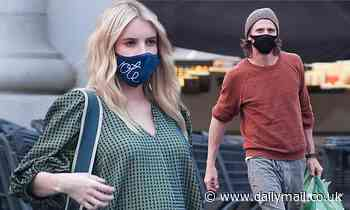 Emma Roberts shows off her growing baby bump on grocery run with boyfriend Garrett Hedlund