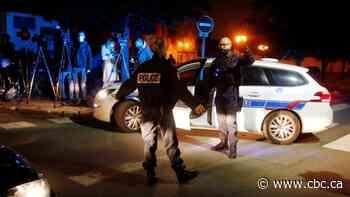 Police shoot dead a man who slit teacher's throat in Paris suburb