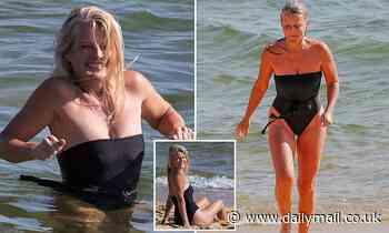 Simone Callahan shows off her incredible beach body as she enjoys a dip in the Melbourne water