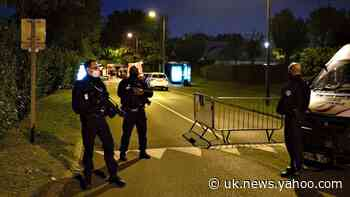 Knife-wielding man accused of beheading teacher is shot by police in Paris suburb