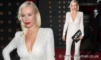 Denise Van Outen sizzles puts on a VERY busty display in a plunging jumpsuit after her Cabaret show