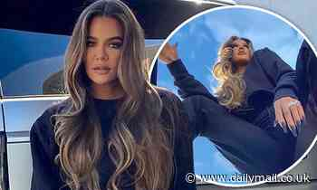 Khloe Kardashian gets creative with her posing as she promotes a sweat set from Good American