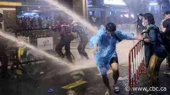 Thai police fire water cannons on defiant anti-government protesters