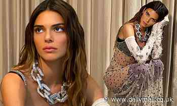 Kendall Jenner is a vision of glamor as she models a sheer gown from Givenchy's new collection