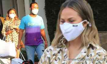 Chrissy Teigen and John Legend emerge from lockdown to shop in LA