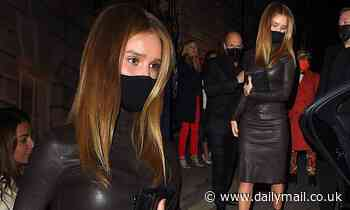 Rosie Huntington-Whiteley wears a brown leather dress during night out with Jason Statham in Mayfair