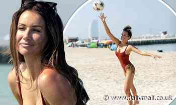 Love Island's Laura Anderson wows in plunging swimsuit on the beach in Dubai