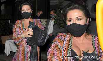 EastEnders star Jessie Wallace nearly spills out of her multicoloured wrap dress after a night out
