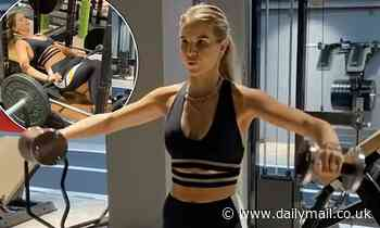 Vogue Williams shows off her taut abs in black lycra as she hits gym
