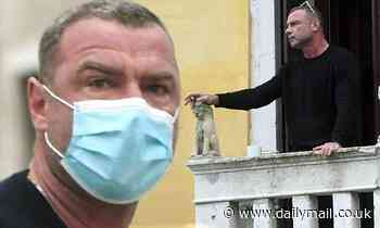Liev Schreiber takes a smoke break on his balcony in Venice as he appears to flout quarantine rules