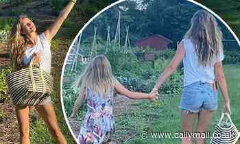 Gisele Bundchen picks fresh food from a garden with her daughter Vivian - Daily Mail