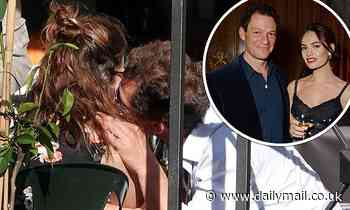 Dominic West and Lily James 'put on a cosy display kissing and cuddling on their flight to Rome'