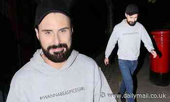 Rylan Neal-Clark cuts a casual figure in a grey hoodie and black cap
