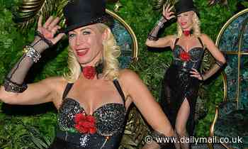 Denise Van Outen commands attention in a sequin bustier and a black semi-sheer skirt
