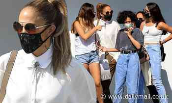 Jennifer Lopez is chic in oversized cream blouse while shopping on Rodeo Drive with the kids