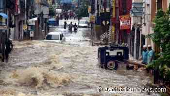 Jalan-jalan Hyderabad India Terendam Banjir, Mengubah Mobil Menjadi Perahu Rusak - Serambinews.com