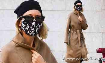 Naomi Watts looks chic in a camel coat and a cute beret as she takes her dog for a walk in NYC - Daily Mail