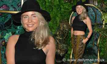 TOWIE's Lydia Bright showcases her fit physique in a black crop top and snake print trousers