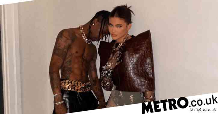 Kylie Jenner poses for flirty photo with topless Travis Scott as they 'dress up' for date night