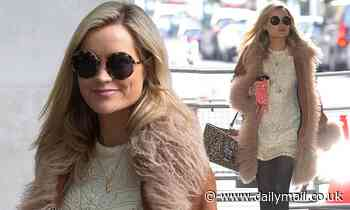 Laura Whitmore looks retro chic in seventies style fur coat and lace dress
