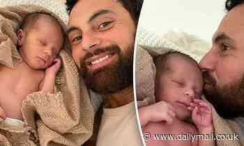 Cameron Merchant shares adorable photos snuggling up to newborn son Ollie