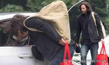 Keanu Reeves, 56, gives girlfriend Alexandra Grant, 47, a kiss goodbye as he returns to Matrix 4 set