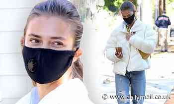 Nina Agdal sports a puffer jacket on a coffee run after leading a fitness class in Amagansett