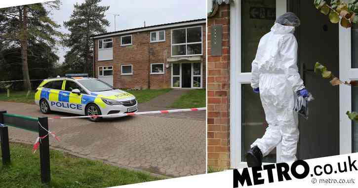 Two men arrested for murder after woman found dead in flat