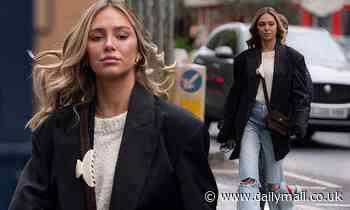 Delilah Belle Hamlin exudes style in an oversized black blazer and jeans in London