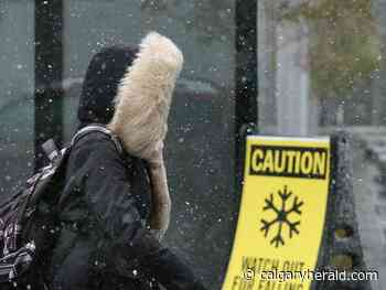 Cold front, flurries sweep into southern Alberta; warnings scaled back - Calgary Herald