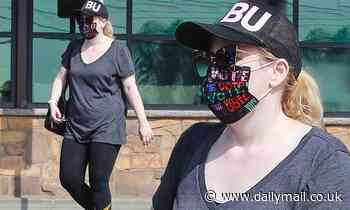 Rebel Wilson goes Sunday casual in baggy t-shirt and leggings as she shops for groceries in LA