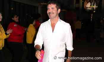Simon Cowell pictured walking with son Eric following bike accident – details