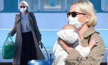 Michelle Williams makes her first appearance with baby number two during family outing